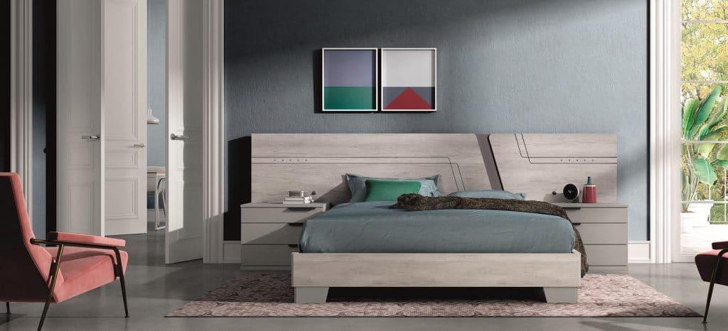 Habitación de matrimonio con cama y mesilla