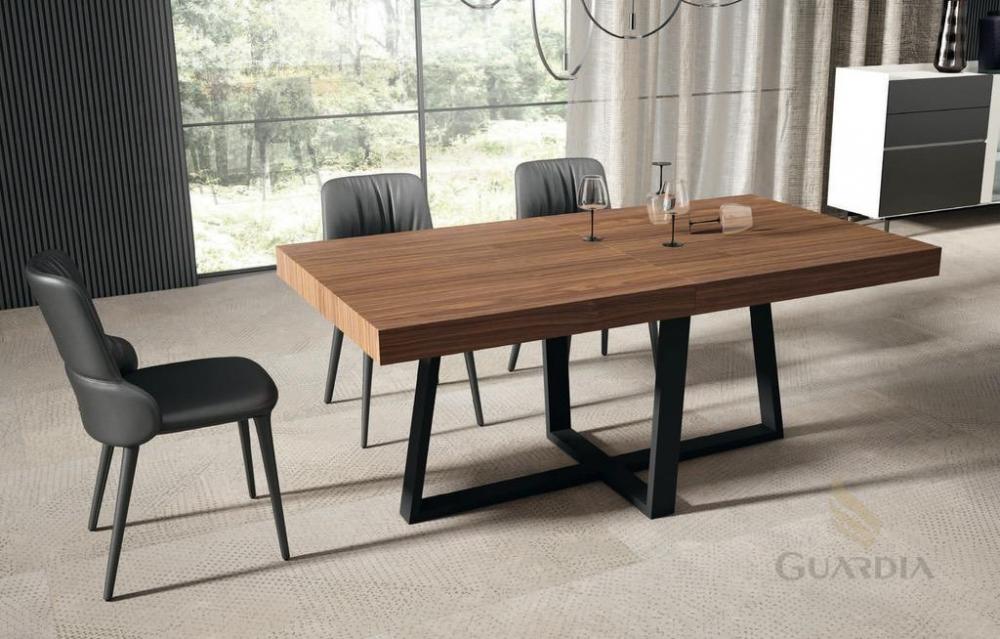 Mesa de salón extensible en nogal y carbono